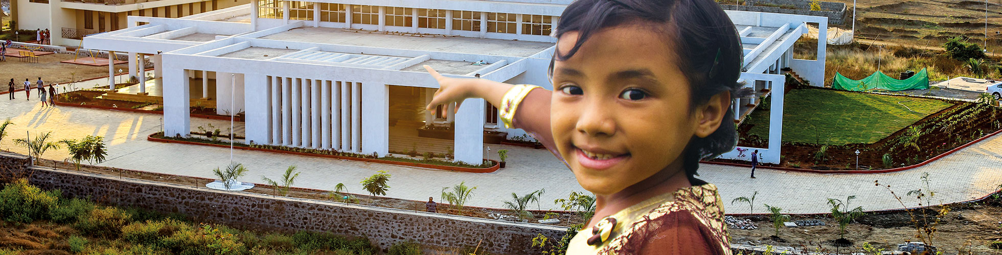 Girl pointing at building